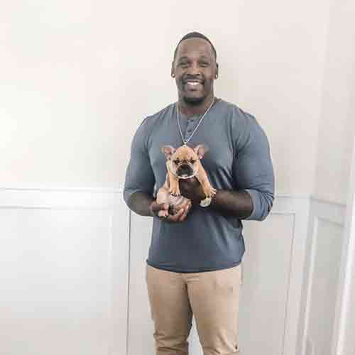 Arthur Moats and his french bulldog